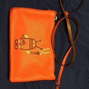 Orange Coach Keith Haring crossbody purse